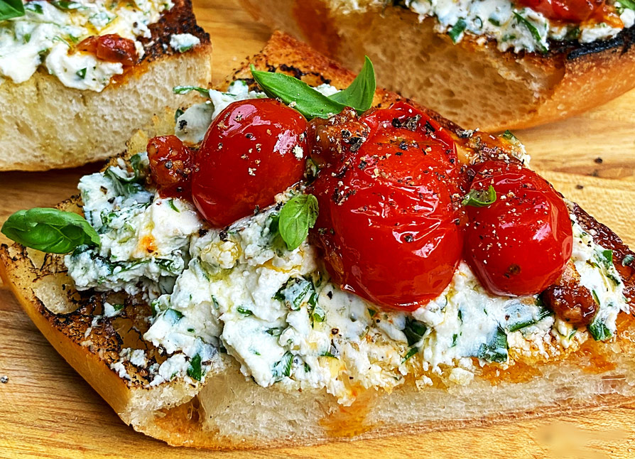 Garlic and Herb Goat Cheese Toasts with Blistered Tomatoes